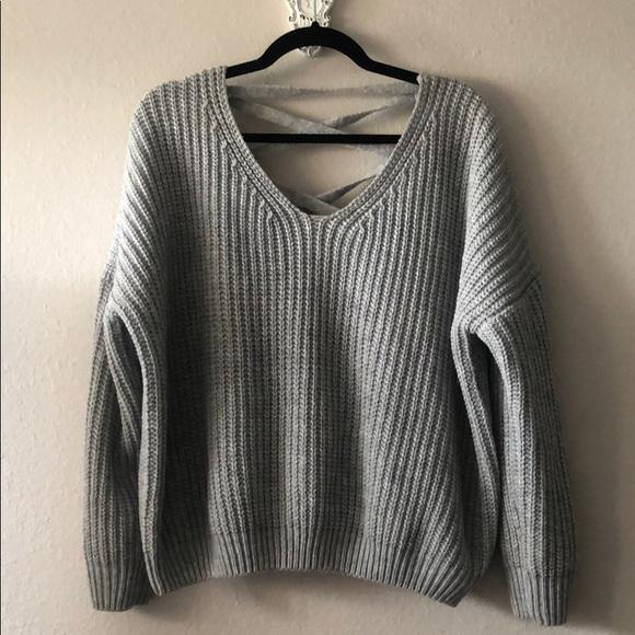 7f204fb68068aa Gray cable knit sweater with criss cross back. M_5b8d88e51b3294c9e4d063ea